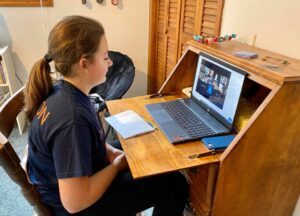 A broadway kid watching a live show online